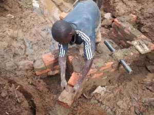 The Water Project : 20-kenya4715-building-the-wall