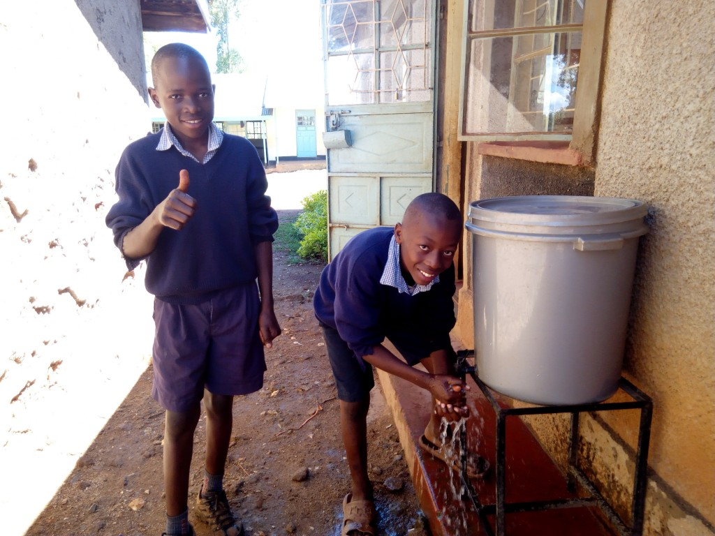 5 kenya4597 Preston and Billy use their hand-washing station installed last year