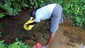 The Water Project : 1-kenya4845-lady-fetching-water-at-musila-spring