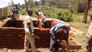 The Water Project : 13-kenya4661-artisans-and-locals-working-on-latrines