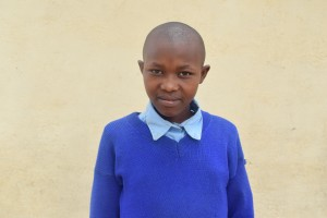John Ndanu, discussing her newly donated water project in Kenya